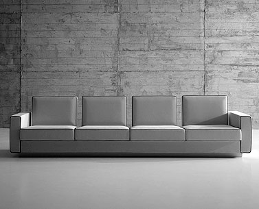 SA34: 1959  |                                      Eero Saarinen                                              Four seat sofa with wooden structure, lined with foam. Different density foam cushions. Not removable upholstery in leather or fabric.