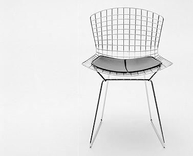 BE04:  1952  |                                      Harry Bertoia                  Side chair with chrome steel wire frame and removable cushion in leather or fabric.