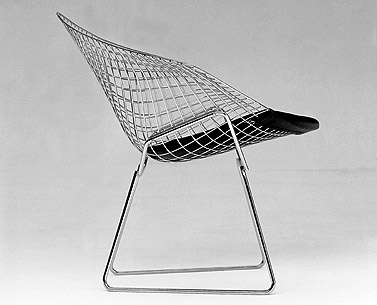 BE05: 1952  |                                      Harry Bertoia                  Armchair with chrome steel wire frame and removable cushion in leather or fabric.
