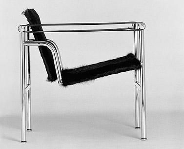 CO05: 1927-28  |                                        Le Corbusier      Armchairwithchrome-plated tubular steel frame. Seat and back inhide in a variety of colors or cowhide. Arms in a continuous band of strap leather.