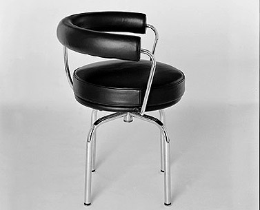 CO15: 1928  |                                      Charlotte Perriand                  Swivel chair with tubular steel frame in epoxy enamel or polished chrome. Seat and back covered in expanded foam. Upholstery in leather or fabric.