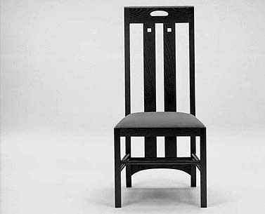 MA34:  1900  |                                      Charles Rennie Mackintosh                                       Chair with frame in black lacquered ash. Seat upholstered in expanded foam covered in velvet, fabric or leather. Back cm.106 high.   This chair was the basic design used in the White Dining Room and in the Cloister Room of Miss Cranton's Tea Room in Ingram Street, Glasgow.