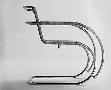 MI05: 1927  |                                      Ludwig Mies Van Der Rohe                  Armchair with tubular steel frame polished chrome. Seat and back in hand woven natural cane. Available also in pith.