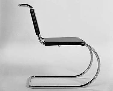 MI14: 1927  |                                      Ludwig Mies Van Der Rohe                                       Side chair with tubular steel frame in polished chrome . Seat and back in hide in a variety of colors.