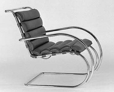 MI25:  1931  |                                      Ludwig Mies Van Der Rohe                  Armchair with frame in chrome plated tubular steel. Suspension in hide straps. Seat in expanded foam covered with leather.