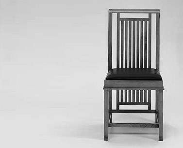 WR14:  1907  |                                      Frank LLoyd Wright                                       Chair in solid cherrywood with back fillets.Available walnut or black stained. Seat upholstered with expanded foam covered withfabric or leather.  This chair was designed for  the Avery Coonley house in Riverside, Illinois in two heights, with medium and low back, in order to emphasize the hierarchical roles of the people seated around the table. For this project, Wright designed all the components of the building, including built-in and movable furnishings.