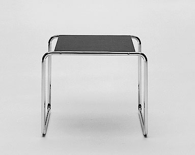 BR09-01:  1925  |                                      Marcel Breuer                 Side table in chrome-plated     tubular steel with black or white laminate top.