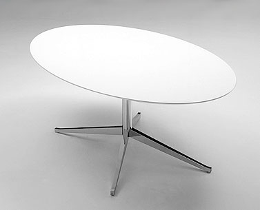 FL69-8: 1961  |                                      Florence Knoll Schust                                       Table with four-star base in chromed steel shaped and tapered. Adjustable foot. Oval top available in marble, lacquered MDF, laminate with visible plywood border or wooden veneered.