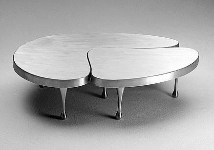 KI09:  1935  |                                      Frederick Kiesler                                       Two part nesting table. Top and legs in cast anodized aluminium.