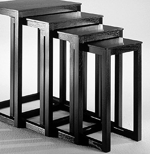 HO39:  1904  |                                      Josef Hoffmann                 Set of four tables with frame in black lacquered solid ashwood or natural cherrywood.   The Wiener Werkstätte interpreted and produced nesting tables in a variety of versions. Hoffmann's version, a set of four geometric tables using square wood stock, is inspired by previous bentwood models manufactured by Thonet and other Central European producers.