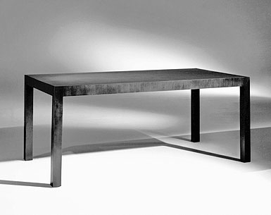 MI69-1: 1921  |                                      Ludwig Mies Van Der Rohe                                      Table with ashwood veneered frame with vertical veins on edges and on legs. Available rosewood, natural or blacklacquered at open pore.
