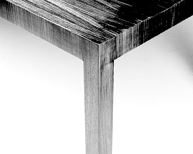 MI69-2:   1921  |                                      Ludwig Mies Van Der Rohe                 Table with ashwood veneered frame with vertical veins on edges and on legs. Available rosewood, natural or blacklacquered at open pore.