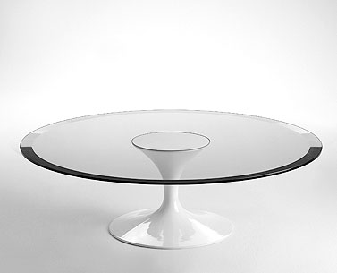 SA59-6: 1958  |                                      Eero Saarinen                                      Low table, base in cast aluminium lacquered black or white. Glass top 19mm. Steel slab lacquered black or white.