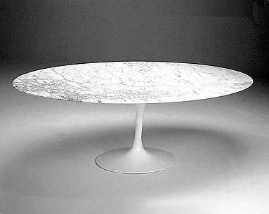 SA69-8: 1956  |                                      Eero Saarinen                 Table with base in black or white lacquered cast aluminum. Oval top cm. 199x121 in a variety of finishes.