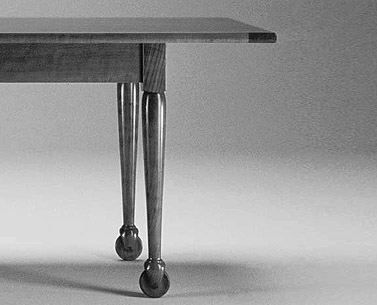 SH39: 1805  |                                        Shakers                 Table with base and top in natural cherrywood. Lacquered metal wheels.