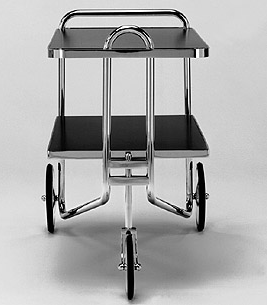 BR49: 1928  |                                      Marcel Breuer                                       Cart with frame in chrome steel tube; ledges, wheels and joints in chromed brass. Top available in several finishes.