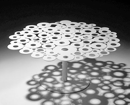 CENTRINO ROUND TABLE:   2009  |                                       Massimo Imparato                  Steel table, with top assembled by electro-galvanized welding rings and steel base. Available in several heights and dimensions, lacquered in a wide range of colours.