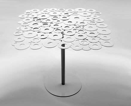 2009  |                                       Massimo Imparato                                       Steel table, with top assembled by electro-galvanized welding rings and steel base. Available round and square in several heights and dimensions, lacquered in a wide range of colours.