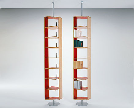 LIBRALTA 1/2:   2003  |                                       Danilo Marcone                                       Massimo Imparato                                      Ranieri  Massola                  Turnable bookcase inbirch plywood either veneered or covered with aminate with border at sight. Base inlacquered aluminium metal. 7 Book-clip in stainless steel. Height 270/285 cm.