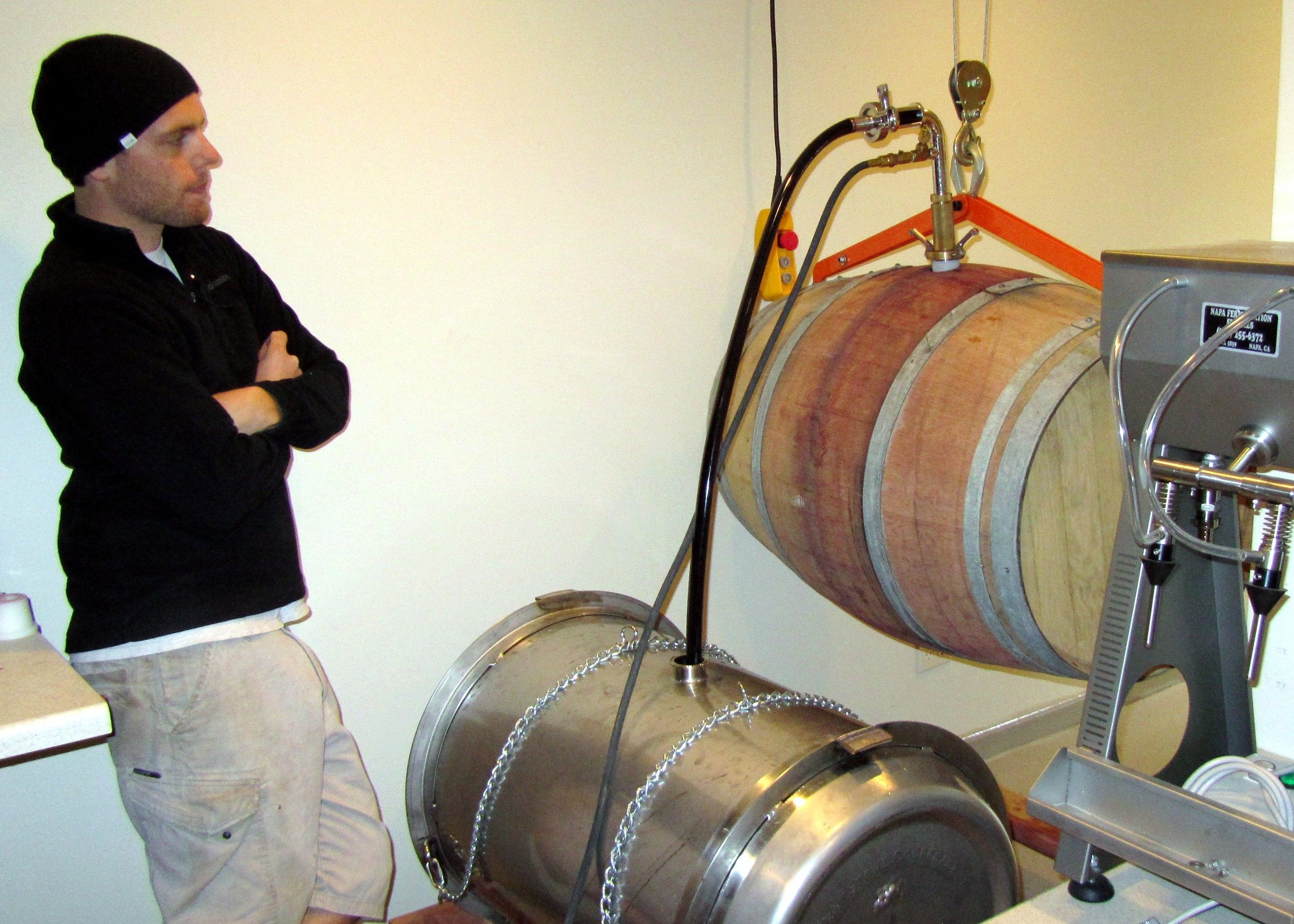 1 Aran Healy emptying barrel into steel tank so the barrel can be cleaned