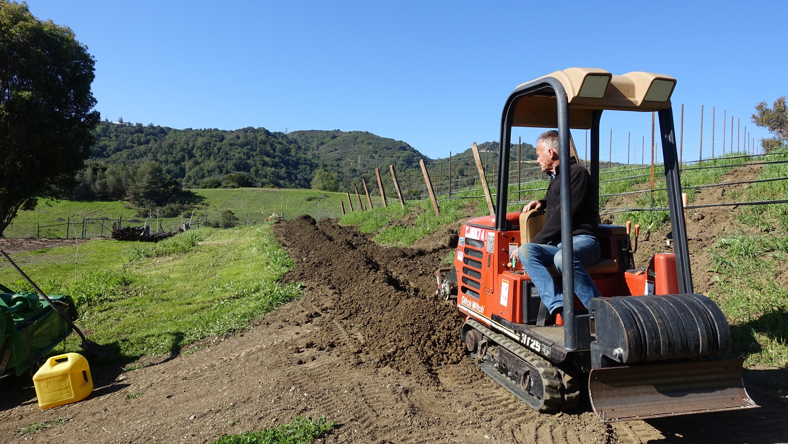 11. Digging irrigation ditches with Ditch Witch