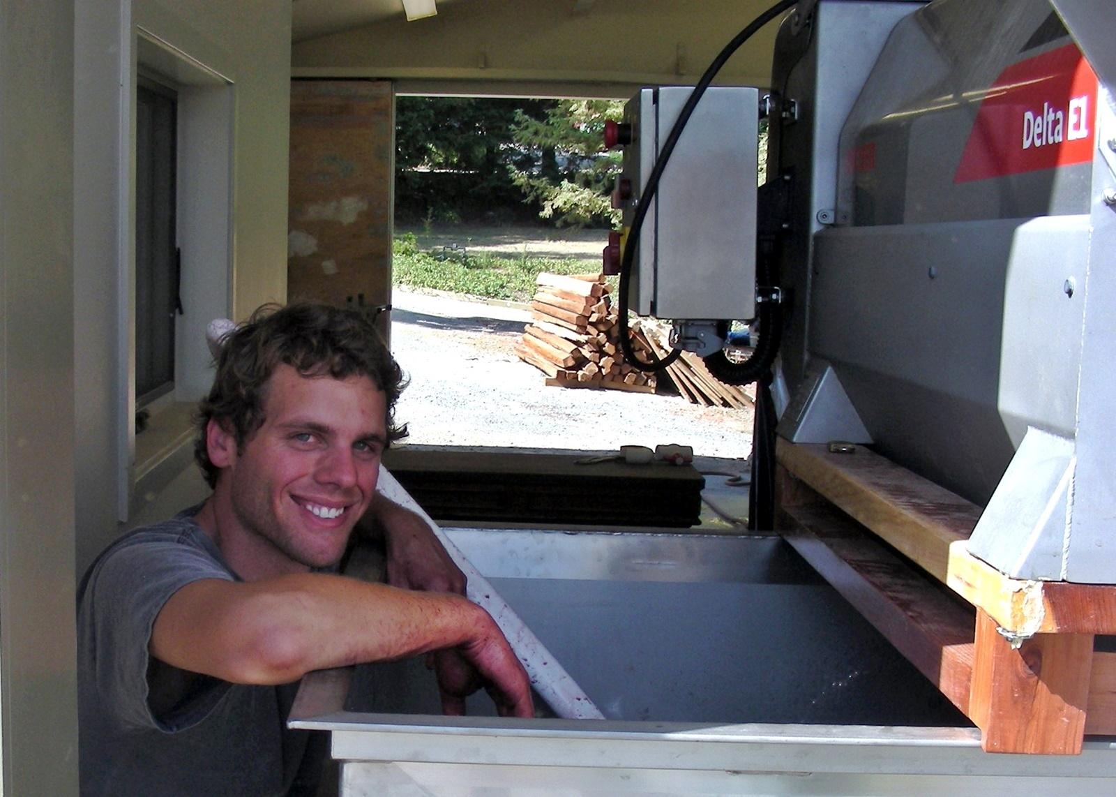 4 Aran Healy watching berries fall into fermentation tank
