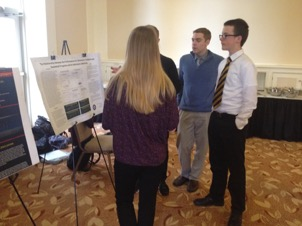 Photo: Students displaying their final poster project during the 2017 Data Jams finale.
