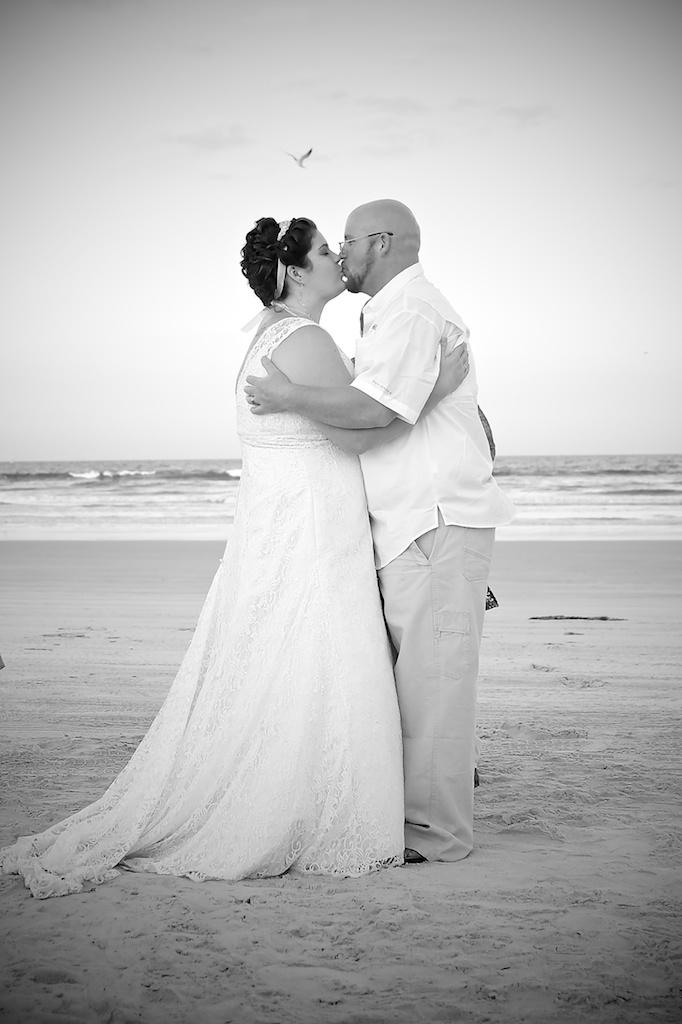 Beach Wedding First Kiss