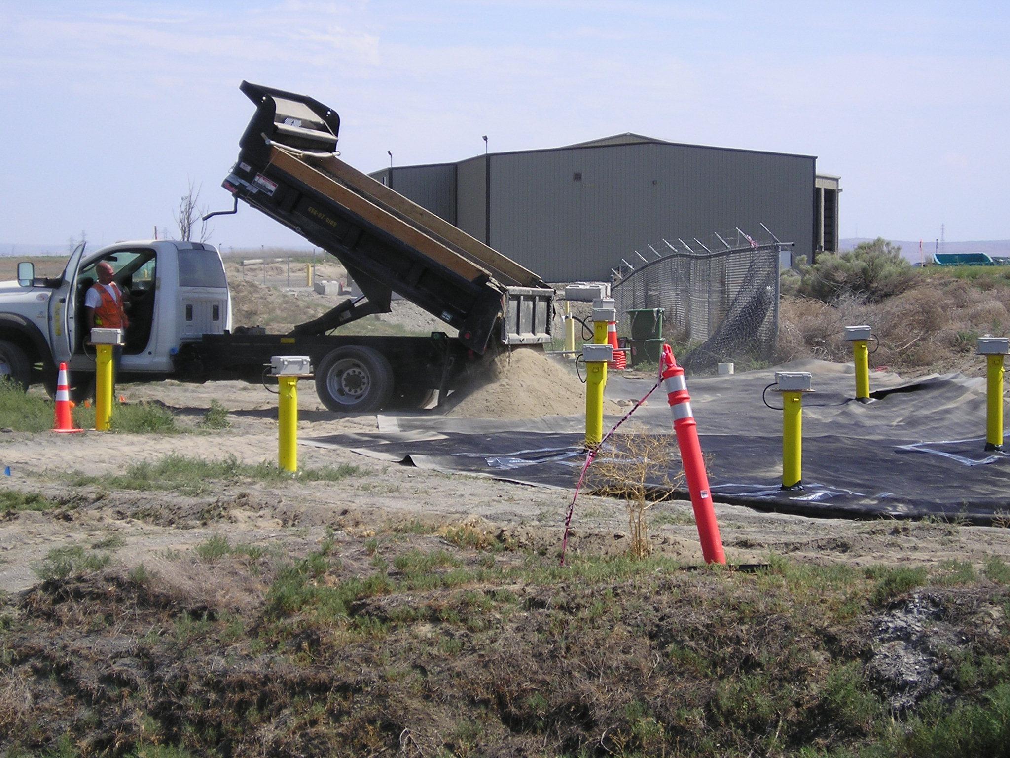 2014-06-02.20 - Placing Soil on HDPE.01.JPG