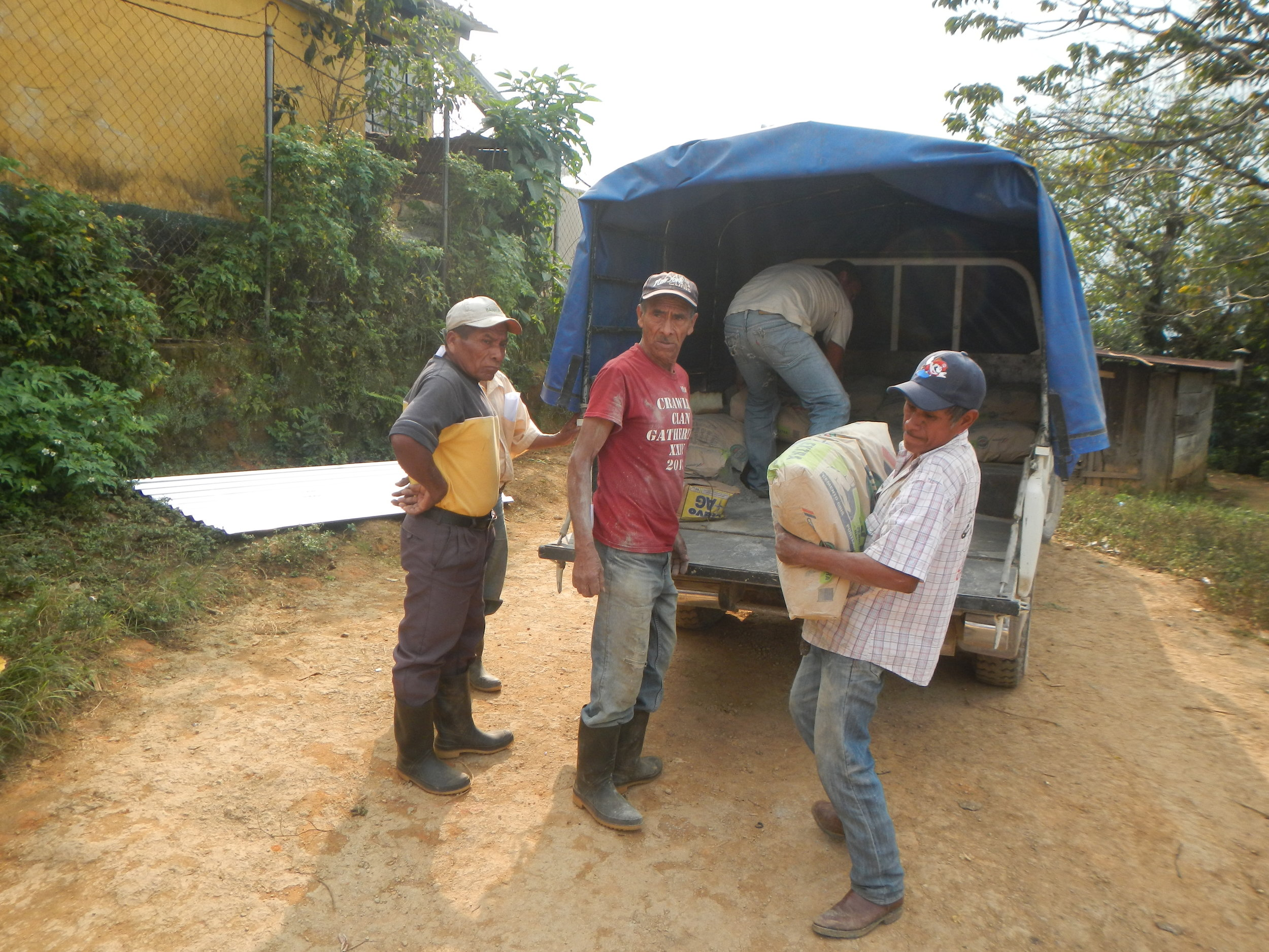 San Francisco villagers loading supplies to build the tank system