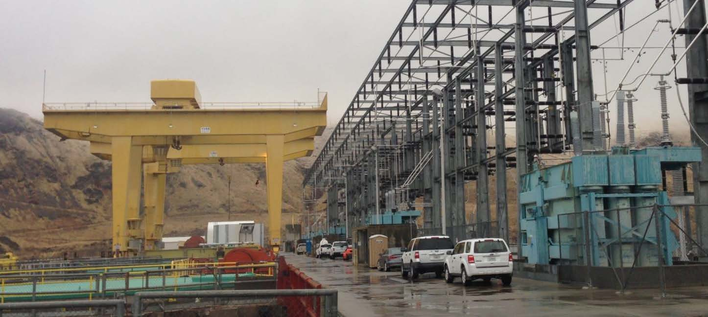 The switchyard and gantry cranes along the top of Wells Dam.