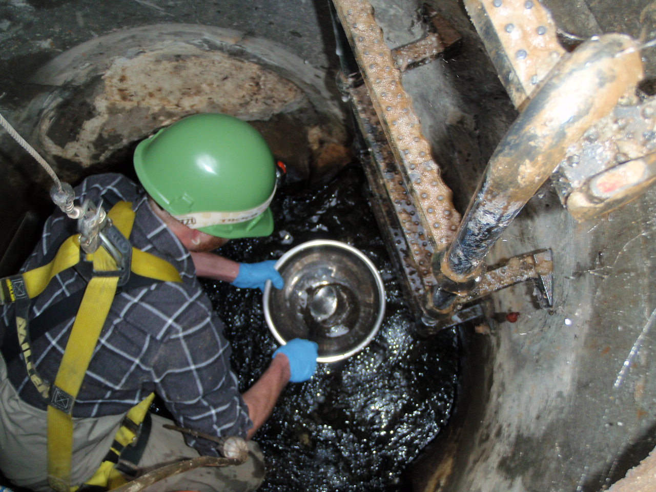 Sediment collection in a storm sewer manhole