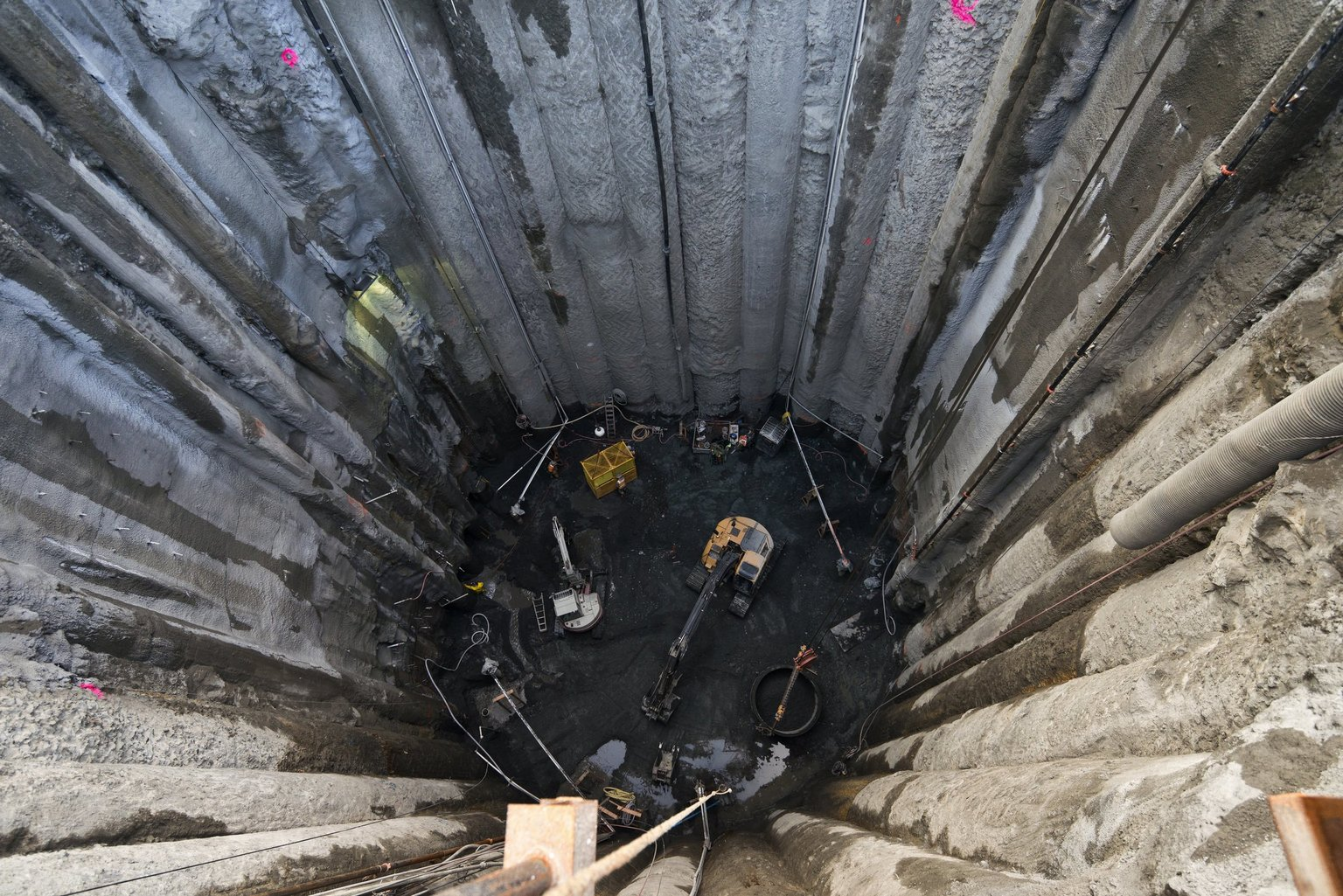 Peering into the 130-foot-deep rescue shaft. Photo credit: Seattle Times