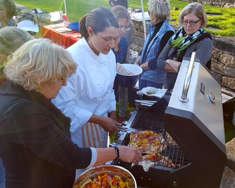 Deja Hart of Newport Cooks making Grilled Scallop-Pesto Pizza