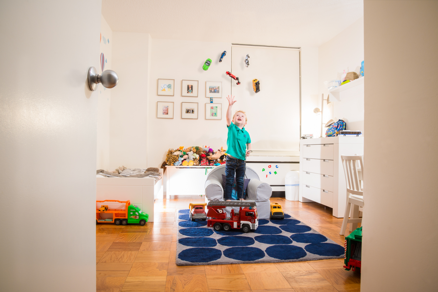 I love this fantasy shoot I did for an amazing family in New York City. Lucas is, a 3 year oldobsessed with trucks. To capture this stage in his life Icreating a sneak peek into a magical fantasy land in his room where gravity was suspended and the wonder of life was explored.