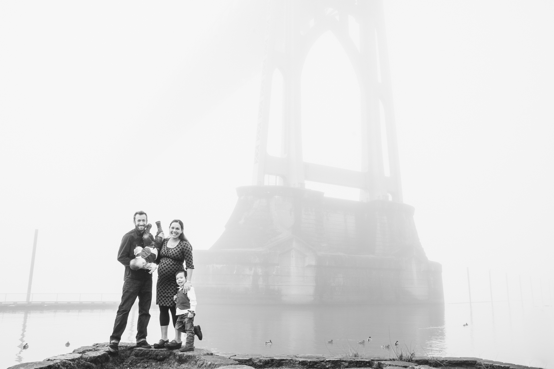 In late January Portland had a crazy week of really heavy fog. It was so beautiful seeing the city and the bridges disappear into the fog and turned into a great backdrop for this family portrait session in Cathedral Park.
