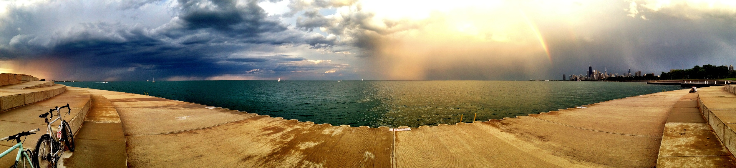 A panorama of the storms to the north and south of my location, including the double rainbow off to the left. Click on it to see it as wide as your browser. Make it full screen!