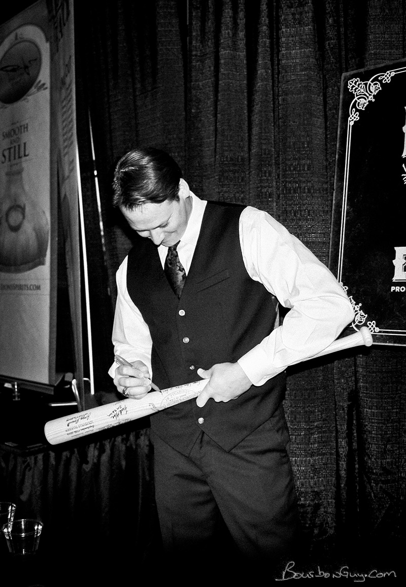 PaulTomaszewski of MB Roland Distillery signing the Louisville Slugger made famous on WhiskyCast