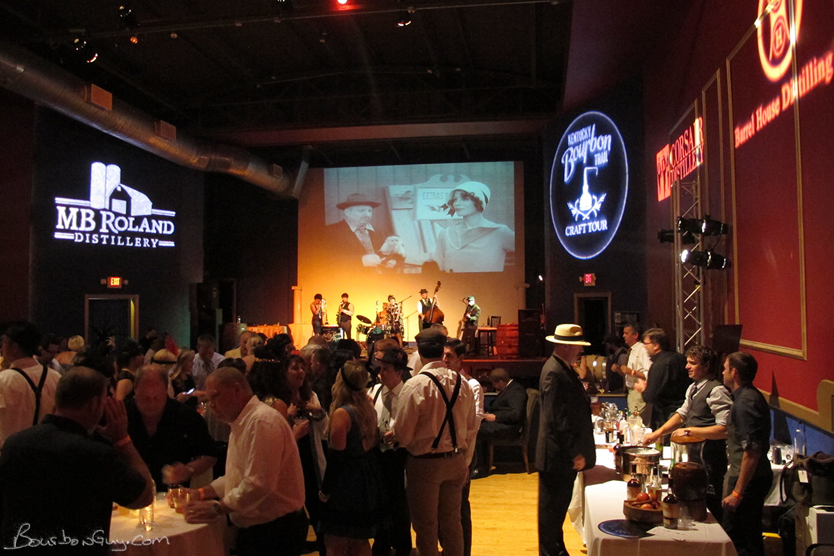 The band, the screen, the distilleries and the costumed attendees all help to set the scene for the ARCO Speakeasy.