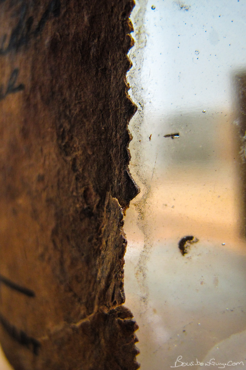 This label was thick as leather, dried out, cracked and peeling, with visible wood pulp.