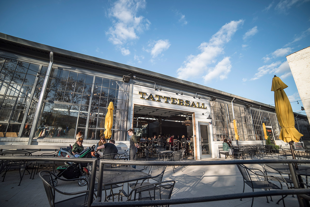 Outside on the patio of Tattersall Distilling. (Photo Credits:Producer: Sam Kovar.Photographer: Tom Okins.)
