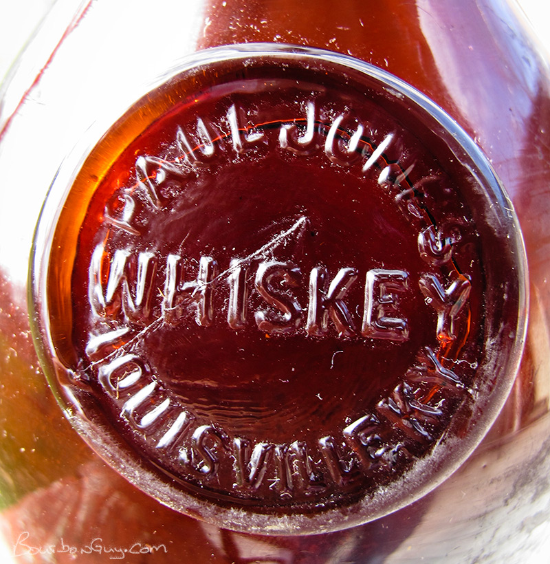 Glass seal affixed to the shoulder of 19th Century Paul Jones Whiskey bottle.