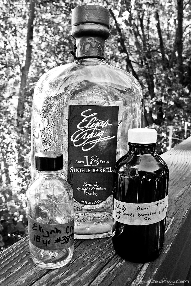 An Elijah Craig 18 year old bottle that has been empty for 4 years plus a sample from it and a sample from a current bottle that have been empty for 4 days.
