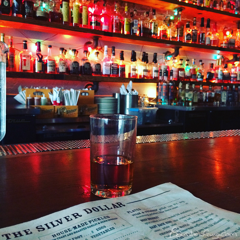 A shot of my glass on the bar of the Silver Dollar.
