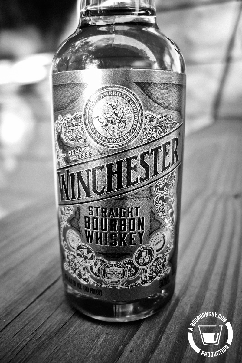 Winchester Straight Bourbon Whiskey in a 50 mL bottle