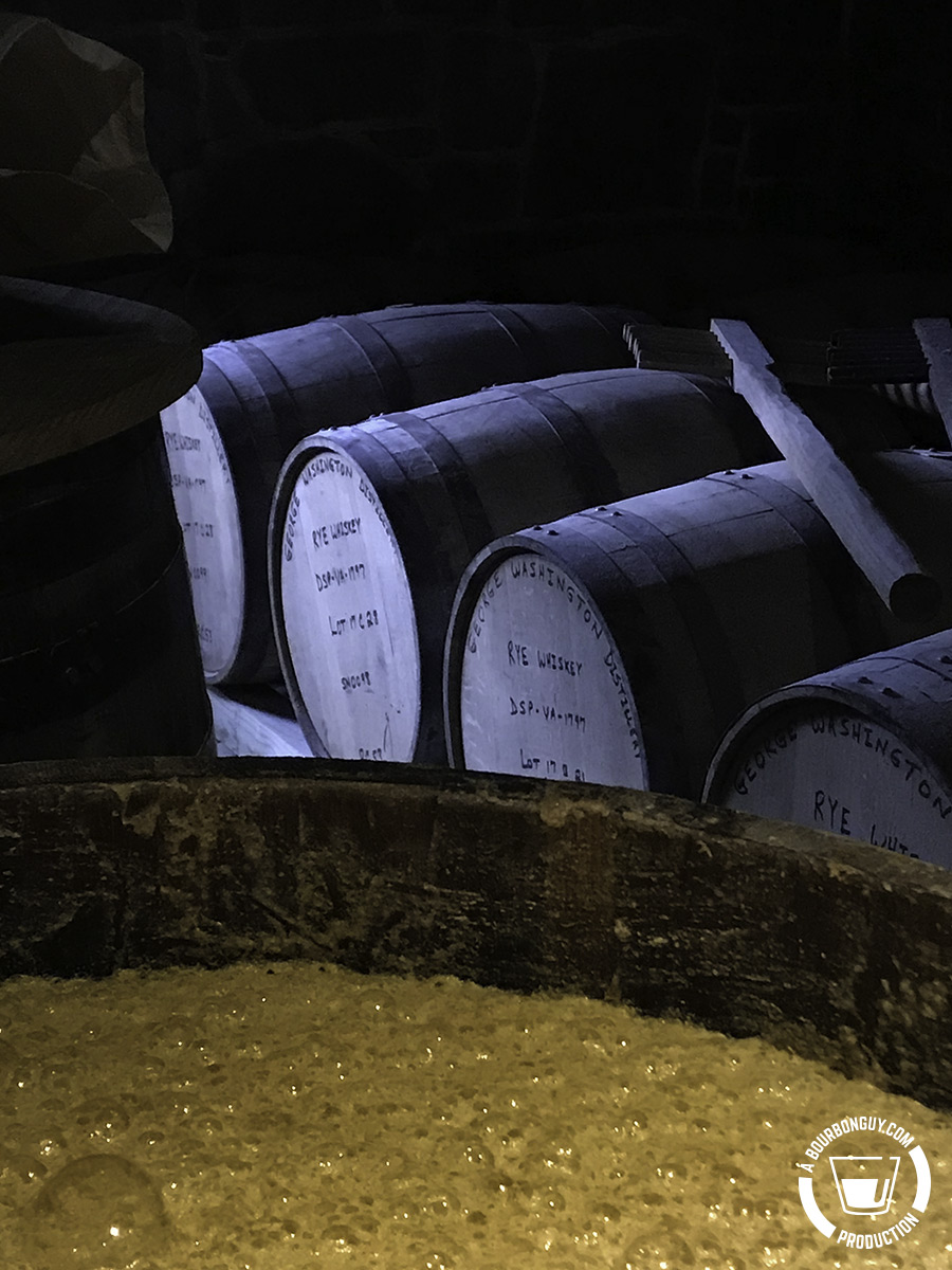 Fermentation in a barrel with unused barrels and a mash rake behind