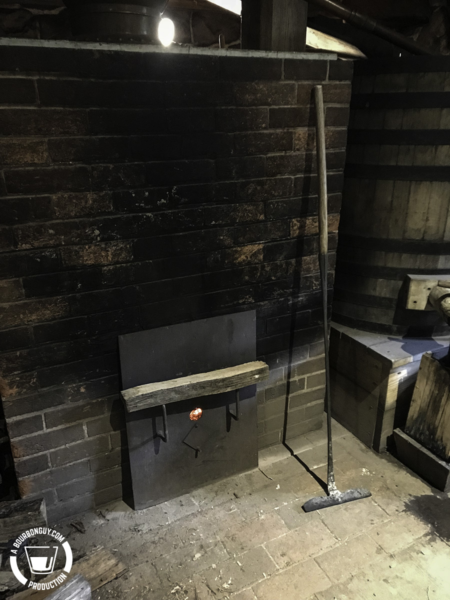 A block of wood across the fire box handles signifies that there need be no more wood added as this distillation has ended for the day.