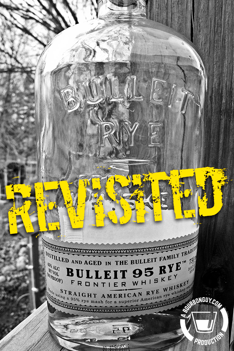"""Image: A bottle of Bulleit rye with the word """"Revisited"""" over it."""