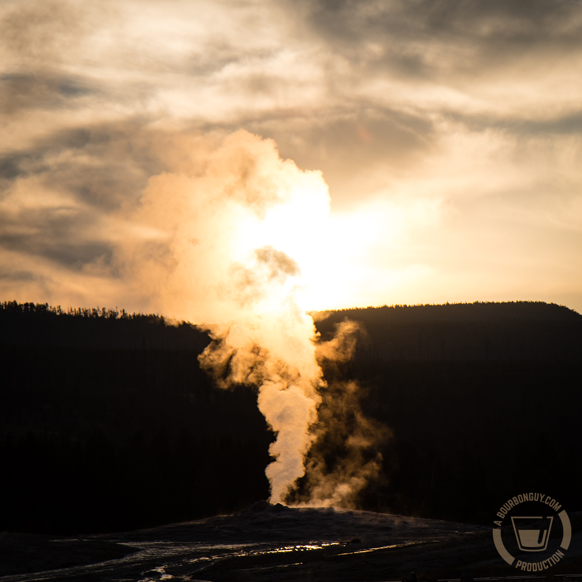 Image: a geyser in Yellowstone National Park at sunrise