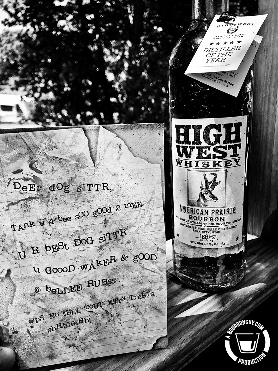 """Image: A bottle of High West American Prairie Bourbon I received as a gift and the card I received with it. The text on the card states: """"Deer dog siTTR, Tank u 4 bee sOO gOOd 2 mEE U R bESt GOG siTTR u GOOOD WAkER & gOOD @ beLLEE RUBss. ps. No tELL 'bout XTra TreEts shHsssHs!"""""""